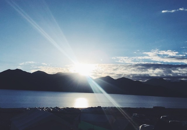 The sun over the mountains in Pangong Tso Lake in Ladakh, India
