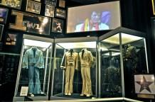 Several of Elvis' famous jumpsuits