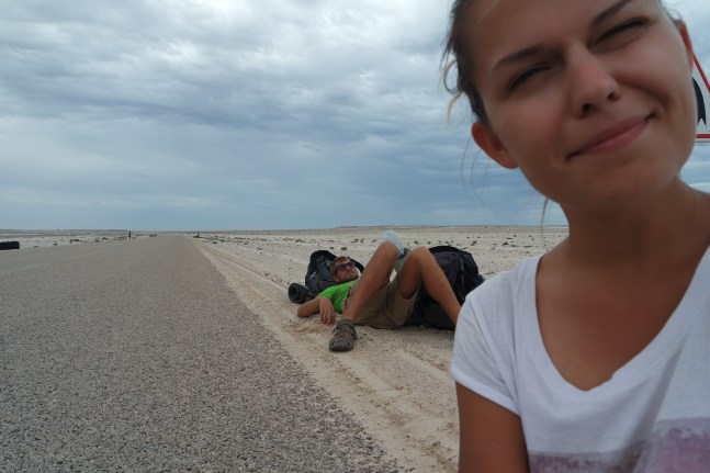 two backpackers hitchhiking through Western Sahara