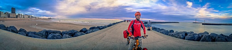 A male cyclist at the seaside in Ostend