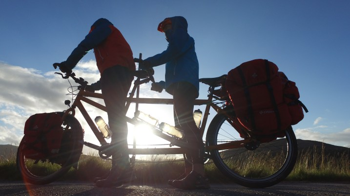 A couple on a touring tandem bicycle in Scottland