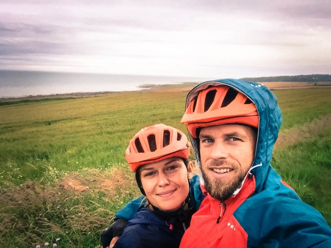 A bicycle rider couple at the Scottish Seaside