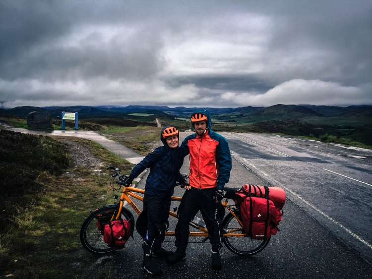 Tandem bicycle rider couple in rain in the nature