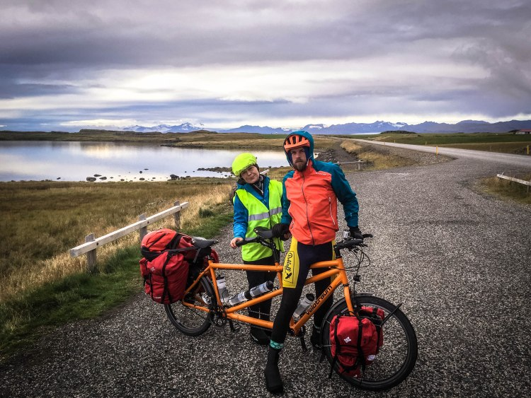 A couple on a tandem bicycle in Iceland