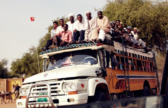 Sudanese transport - Many men riding on a bus