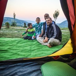 View of a family outside of a tent