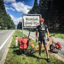 a man in front of a tandem bicycle at the Wurzenpass