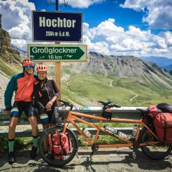 a male and female bicycle rider next to a tandem bicycle at Hochtor