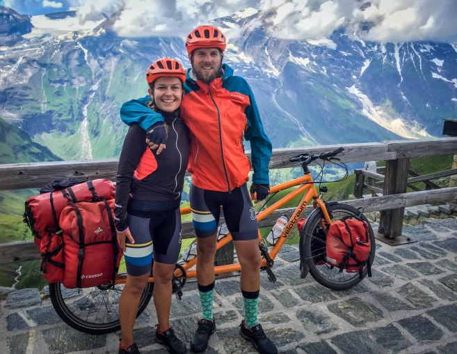 a couple next to a tandem bicycle in the Austrian Alps