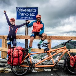 man and women at Edelweißspitze in front of a tandem bicycle