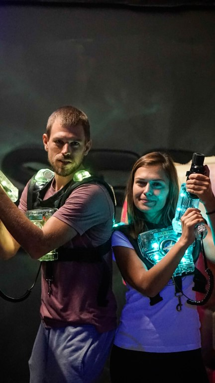 man and woman with lasertag guns