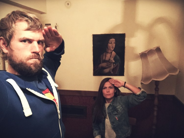 man and woman saluting at the Escape Room Poznan