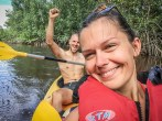a happy couple on a 2-person kayak