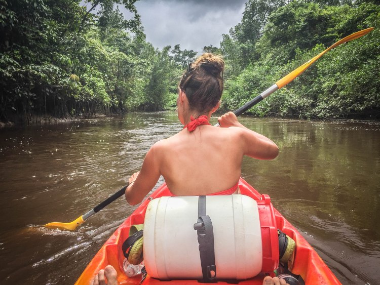 woman on a kayak / / How To Stay In Shape While Traveling
