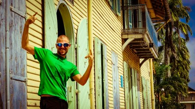 Man posing in front of a building in Cayenne, French Guiana