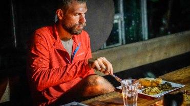 bearded man eating