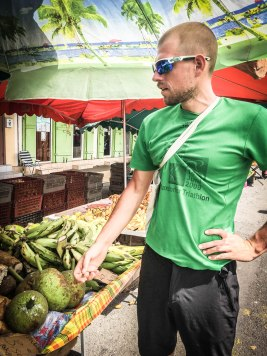 Man wearing sunglasses shopping at the market in Cayenne, French Guiana
