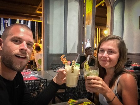 a couple toast with cocktails in a restaurant in French Guiana