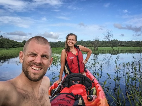 a woman and a guy on a 2-person tandem kayak