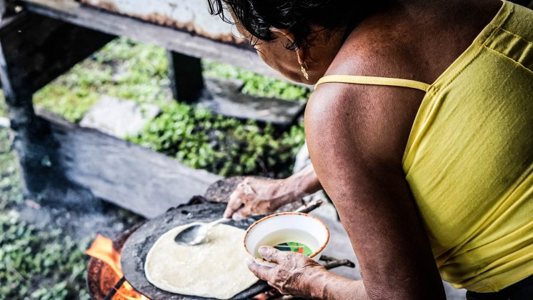 a woman making a bread in Guyana