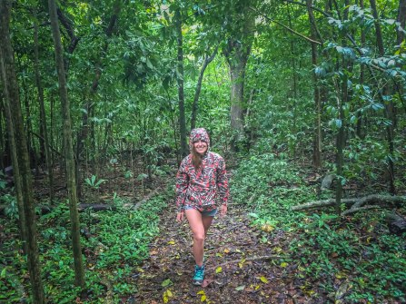 a pretty woman in the rain forest
