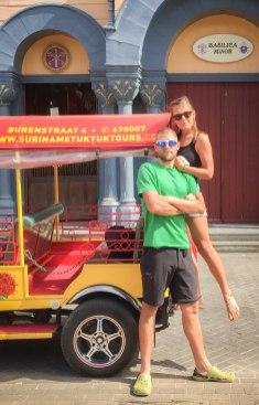 a man next to a pretty women on a tuk-tuk