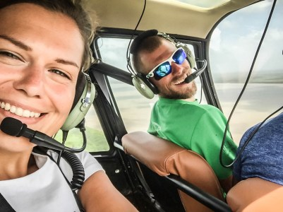 man and woman in a helicopter