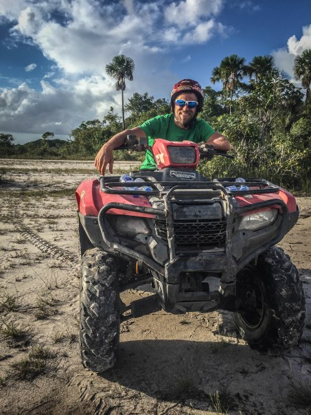 a man on a quad in the savanna in Suriname