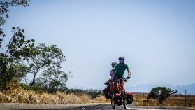 man and a woman riding a tandem bicycle / Cycling through South America