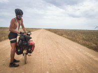 man in the desert next to a tandem bicycle / Cycling through South America