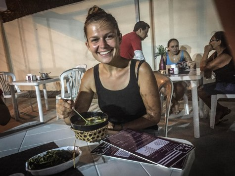 A woman eating Acai in the North of Brazil