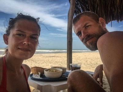 a couple eating at the beach