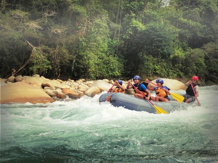 four people rafting