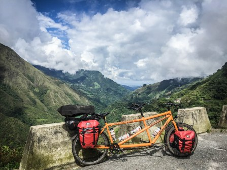 a tandem bicycle leaning against a wall in the mountains / Cycling through South America