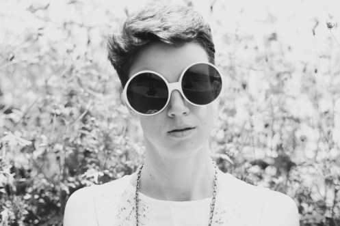 black and white photo of Radio Rose wearing big sunglasses
