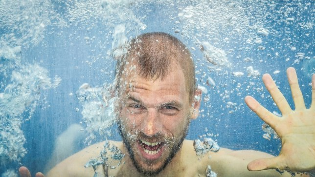 A blonde German man under water / The Art Of Serendipity While Traveling