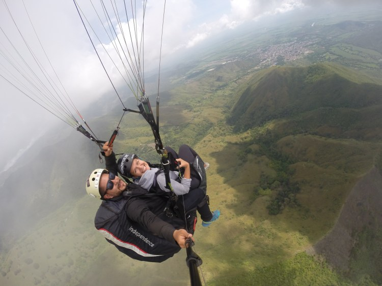 man and woman on a paraglider