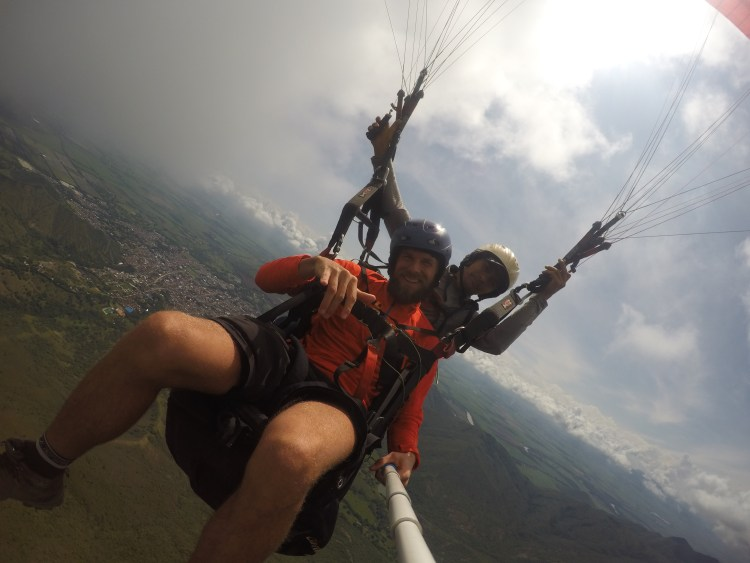 two men doing tandem paragliding