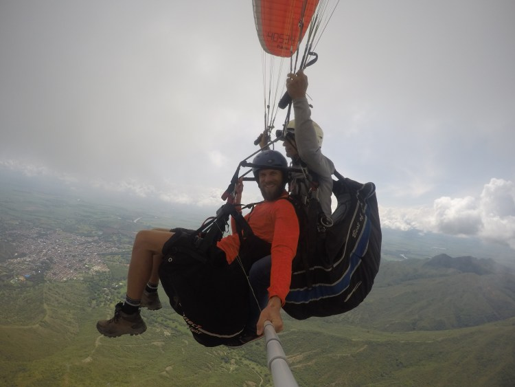 two men paragliding in Colombia