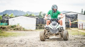 A man riding a quad