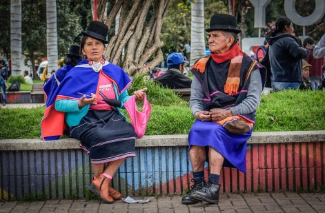 A elderly couple sitting on a wall in Silvia, Colombia