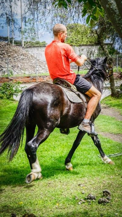 a man horseback riding