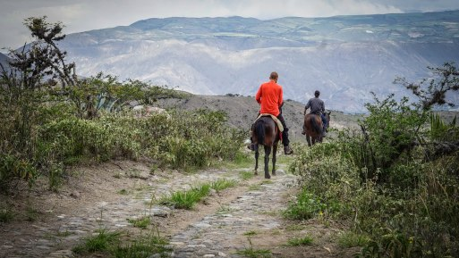 two men on horses in Ecuador