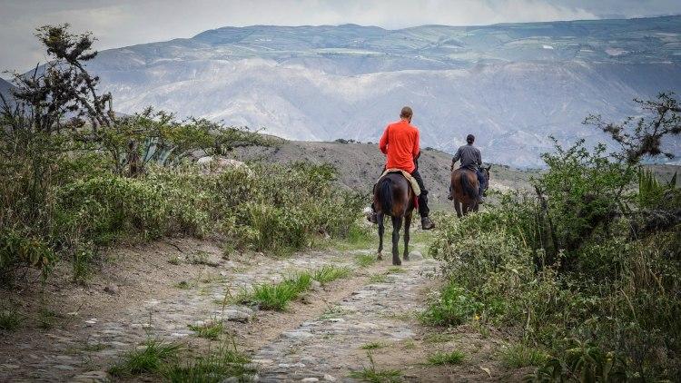 two men on horses in Ecuador