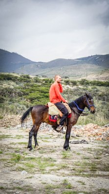 a blond man horseback riding in Ecuador
