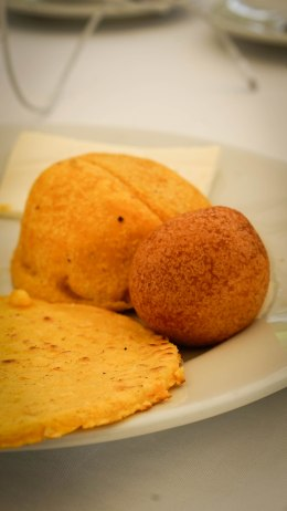 Bunuelos with arepa on a plate