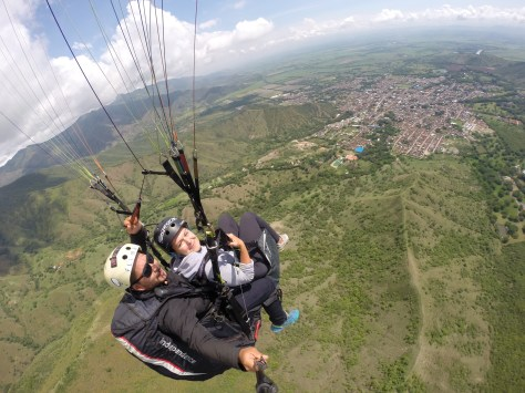 A woman and a man paragliding in Roldanillo, Colombia