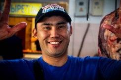 Smiling man wearing a baseball hat