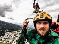 two men doing paragliding in Ecuador