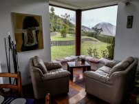 sittings and table in front of a window with nice view in the restaurant El Mirador Del Crater in Ecuador